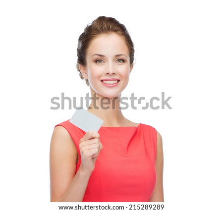 fashion, shopping, banking and payment concept - smiling elegant woman in red dress with blank plastic card - stock photo