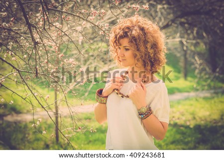 Fashion shot of a beautiful boho style girl on nature background. Boho, hippie.
