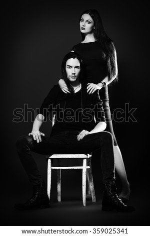 Fashion shot of a beautiful sexual couple in black clothes. Fashion, glamour. Black background.