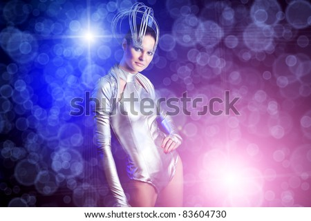 Fashion shot of a beautiful young woman over dark blue  background.