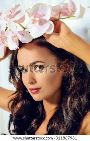 Fashion shot of a beautiful young woman with beautiful long hair. Beauty, fashion. Spa, healthcare.  - stock photo