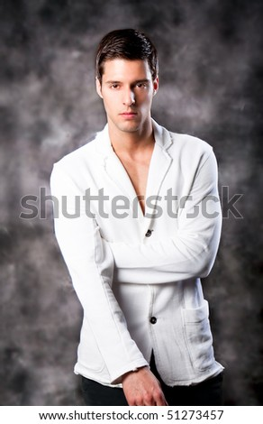 Fashion Shot of a macho Man. A trendy European man dressed in contemporary cloth. He is now a professional model. - stock photo
