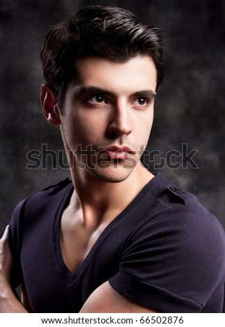 Fashion Shot of a macho Man. A trendy European man dressed in contemporary cloth. He is now a professional model.