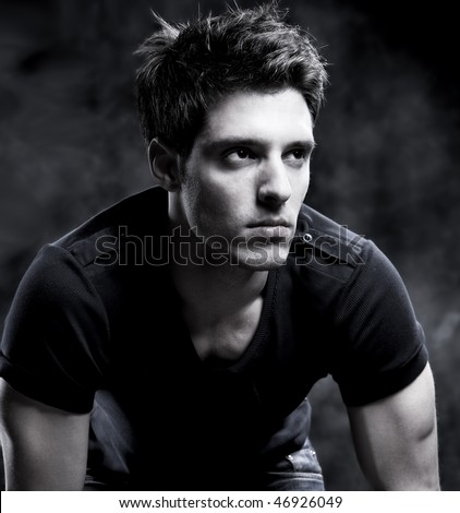 Fashion Shot of a macho Man in black and white.  He is now a professional model. - stock photo