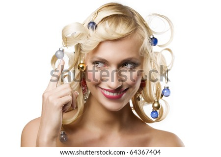 fashion shot of a smiling blond girl with curly hair stylish like a christmas tree with little noel decoration