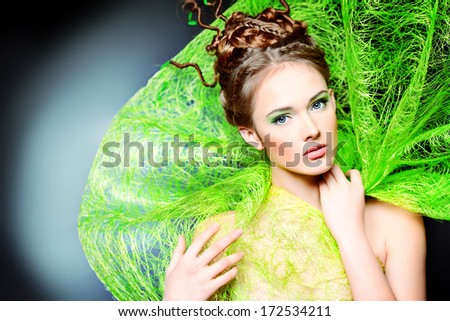 Fashion shot of a stunning female model with beautiful hairstyle. Spring beauty.