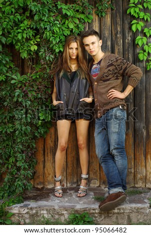 Fashion shot of a trendy boy and girl - stock photo