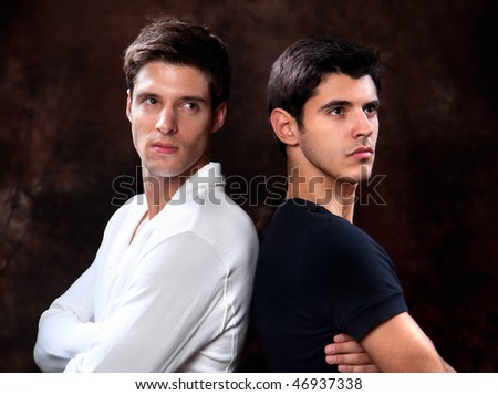 Fashion Shot of a trendy European men dressed in contemporary cloth. They are now a professional models. - stock photo