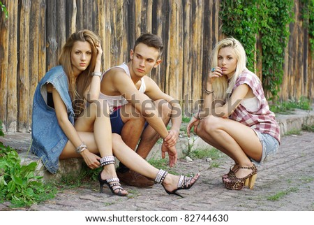 Fashion shot of a trendy group of young people - stock photo