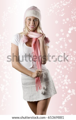 fashion shot of a winter dressed woman in white with a nice pink hat and a pink scarf