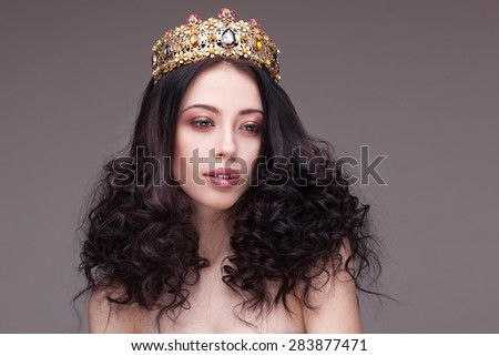 Fashion shot of a woman with diadem and red lipstick - stock photo
