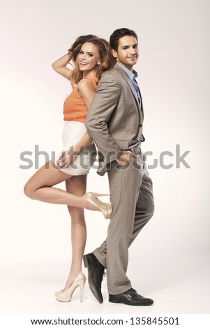 Fashion shot of a young couple - stock photo