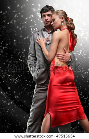 Fashion shot of a Young Couple a trendy european couple dressed in contemporary cloth. - stock photo