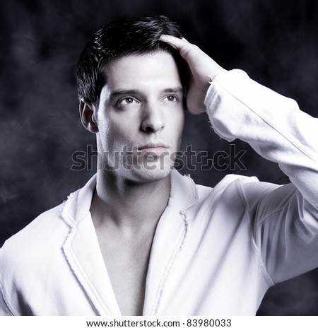 Fashion Shot of a Young Man. A trendy European man dressed in contemporary cloth. - stock photo