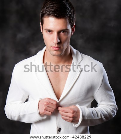 Fashion Shot of a Young Man. A trendy European man dressed in contemporary cloth. He is now a professional model. - stock photo