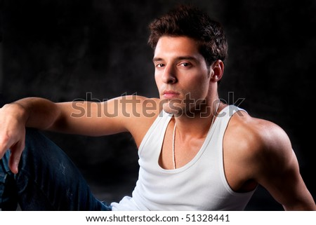 Fashion Shot of a Young Man A trendy European man dressed in contemporary cloth. He is now a professional model. - stock photo