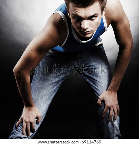 Fashion Shot of a Young Man A trendy man dressed in contemporary cloth - stock photo