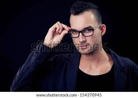 fashion shot of a young man, he is now a professional model - stock photo