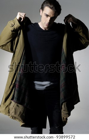 Fashion Shot of a young man in coat. He is now a professional model.