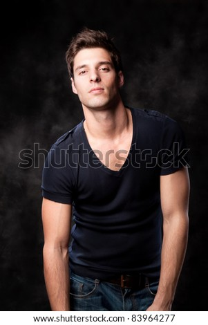 Fashion shot of a young trendy European man - stock photo