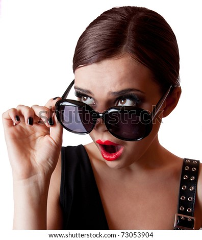 Fashion shot of an astonished young lady - stock photo