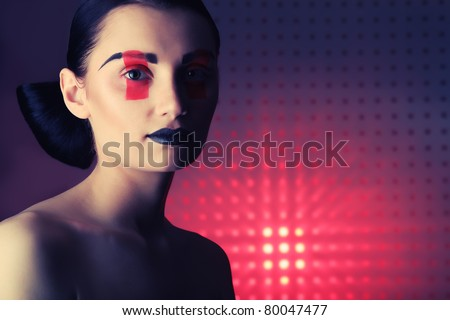 Fashion shot of an attractive model. Make-up. - stock photo