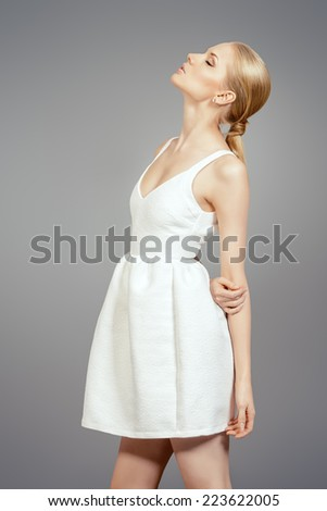 Fashion shot of an elegant female model posing at studio. Beauty, fashion. - stock photo