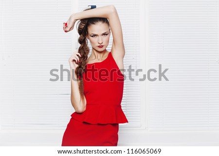 Fashion shot of beautiful girl in red - stock photo