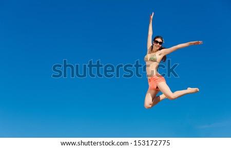Fashion shot of beautiful woman on the beach - stock photo