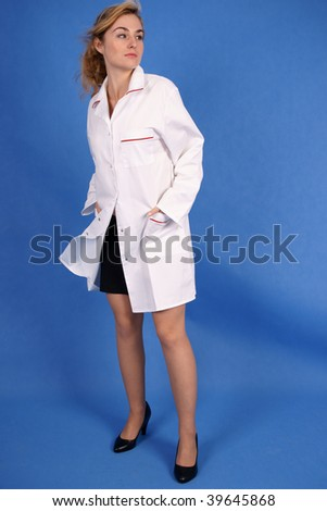 Fashion shot of doctor in medical coat - stock photo