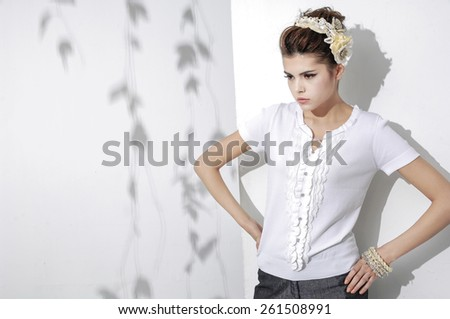 fashion shot of girl posing in light background  - stock photo