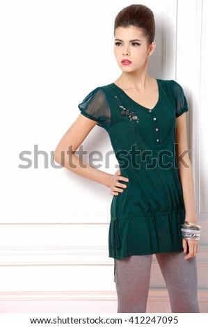 fashion shot of girl posing in studio  - stock photo