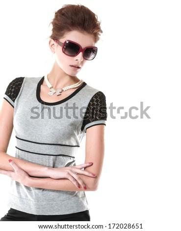 fashion shot of girl wearing sunglasses posing - stock photo