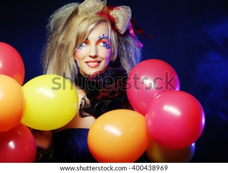 Fashion shot of woman in doll style with balloons. Creative make-up.