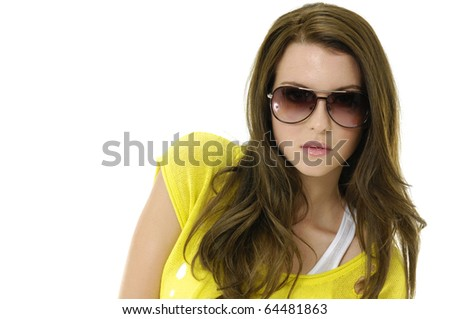 fashion shot of young girl with sunglasses taking pose - stock photo