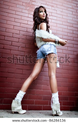 Fashion shot of young woman with sexy legs - stock photo
