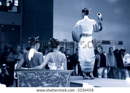 Fashion show. Girls in japanese dress. Blue tint.