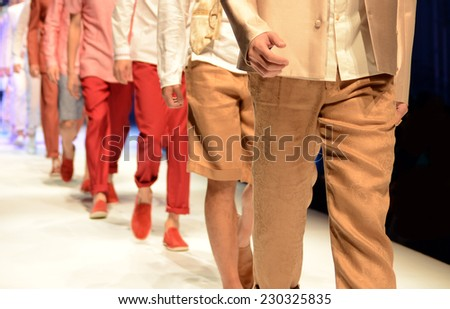 Fashion show with models on the stage. - stock photo