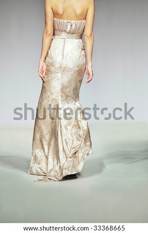 fashion show woman at piste walking in luxury dress - stock photo