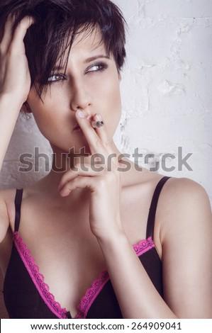 Fashion smoking young woman - stock photo