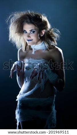 Fashion snapshot - funny model dressed as mummy - stock photo