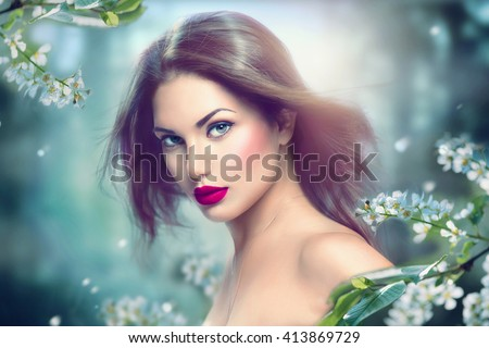 Fashion Spring Model Girl Portrait with Long Blowing Hair. Sexy Glamour Summer Beautiful Woman with Healthy and Beauty Brown Hair with flowers over nature blurred background. Fairy - stock photo