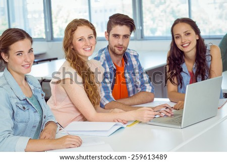 Fashion students looking at camera at college