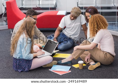 Fashion students working as a team at the college - stock photo