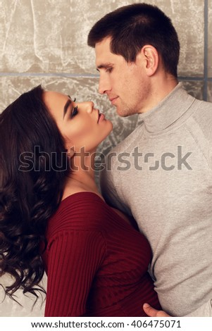 fashion studio family portrait. beautiful tender couple, pregnant woman posing with handsome man