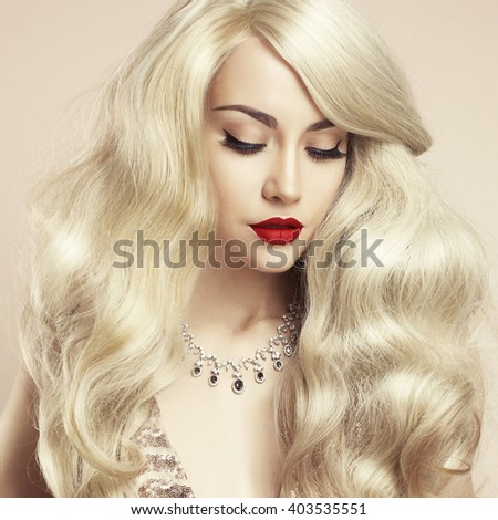 Fashion studio photo of beautiful blonde with magnificent hair. Perfect makeup - stock photo