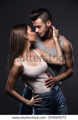 Fashion studio photo of beautiful handsome couple in love.Studio fashion portrait. - stock photo