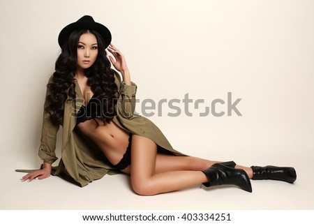 fashion studio photo of beautiful sensual asian woman with long dark hair in lingerie, hat and shoes - stock photo