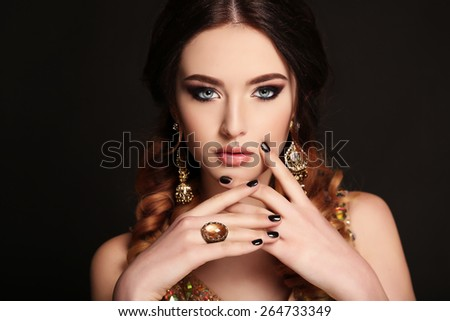 fashion studio photo of beautiful sensual woman with dark hair and bright makeup, with bijou   - stock photo
