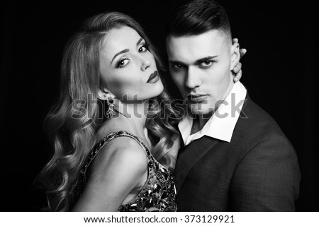 fashion studio photo of beautiful sexy couple in elegant clothes. love story, Valentine's day